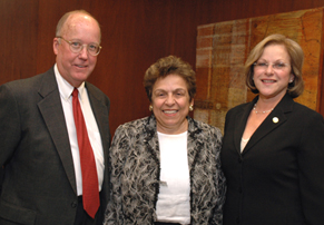 Marcia Cypen, Executive Director of Legal Services of Greater Miami (right), stands with Eugene Stearns of Stearns Weaver Miller, and Donna E. Shalala, President of the University of Miami.