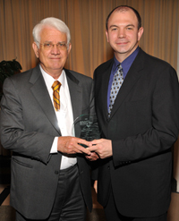 Ralph Livingstone, left, receives his award from Charles Pettigrew of the MetLife Foundation.
