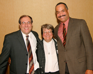 Sister Helen Prejean stands with Daniel K. Glazier, LSEM Executive Director and General Counsel, left, and Reuben Shelton, President of LSEM's Board of Directors.