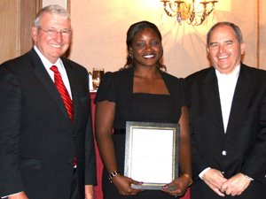 Wells, left, stands with Legal Services Alabama Employee of the Year Jaffe Pickett and state bar president Mark White.