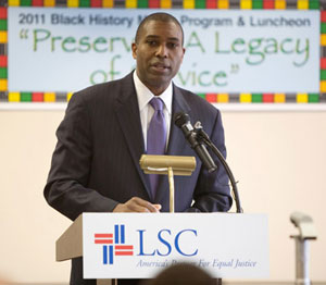 Above: Assistant Attorney General Tony West speaks at LSC's Black History Observance. Below: West stands with LSC President James J. Sandman (left) and LSC Board Chairman John G. Levi. Photos by Dakota Fine.